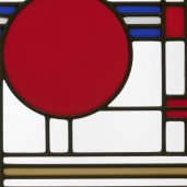<p>Go upstairs to the Art Deco Galleries to find this brightly colored, functional work of art. This artist combined lots of geometric-shaped pieces of glass to make this window. Name the largest shape.</p>