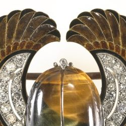 <p>Get decked out in the Art Deco Galleries on Level 3 with this brooch fit for a pharaoh. Who made the brooch?</p>