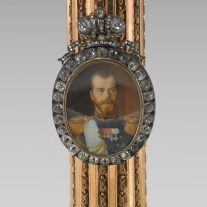 <p>Fabergé and Russian Decorative Arts Galleries, Level 2</p> <p>Look for the Imperial Column Portrait Frame that holds a portrait of Tsar Nicholas II. Many rulers have widely distributed their own images to heighten their prestige. What are some other dazzling objects with images of important people?</p>