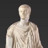 <p>Ancient Galleries, Level 2</p> <p>Enter the nearby Classical Court to find a statue of the Roman emperor Caligula. His image resembles representations of Julius Caesar and Augustus, his powerful ancestors. Can you think of anyone else in history or the present day who makes connections with past rulers?</p>