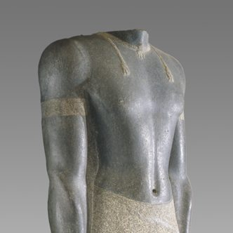 <p>Ancient Egyptian Gallery: </p> <p>This is Senkamanisken, who was the King of the ancient African empire of Kush. Look closer at his proportions—how would you describe his size? Why do you think he was depicted in this way? </p>